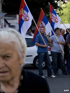 Serbs stand with flags in the Serbian part of Mitrovica, Kosovo, 22 July