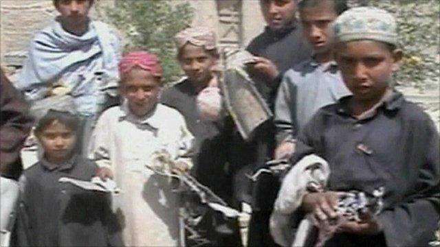 Children hold debris
