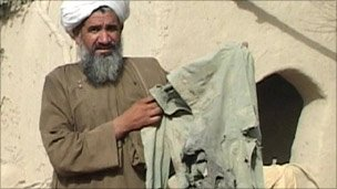 Man with torn clothing
