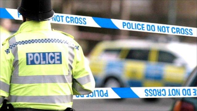Policeman at scene of crime