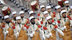 Soldiers from the French Foreign Legion parade down the Champs-Elysee in Paris on Bastille Day, 14 July 2010