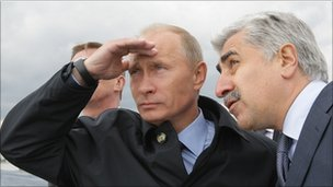Russian Prime Minister Vladimir Putin and Sukhoi head Mikhail Pogosyan during a test flight of a new fighter jet