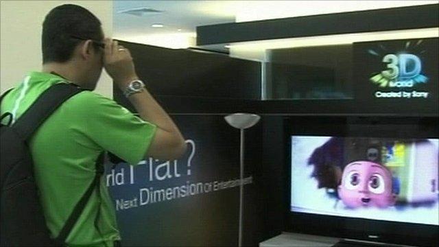 A man watching a 3D TV