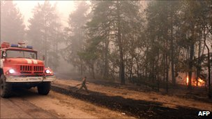 A fire-fighter moves to tackle flames in Beloomut near Moscow, 31 July