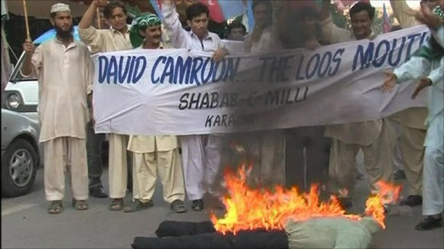 Protesters burning an effigy of David Cameron