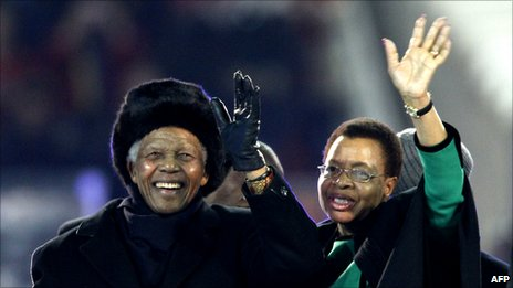 Former South African President Nelson Mandela (left) and his wife Graca Machel greeting fans before the 2010 World Cup football final
