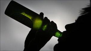 Generic man drinking bottle of lager