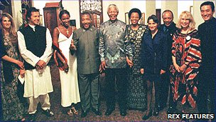 Nelson Mandela (centre) with Charles Taylor and Naomi Campbell directly to his right