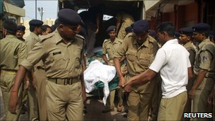 Police carry the body of a wounded colleague in Chhattisgarh in June