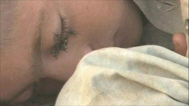 Pakistani boy sleeping rough