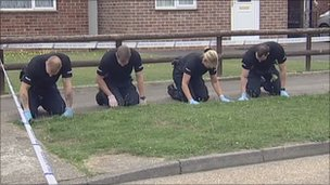 Forensic officers search for clues
