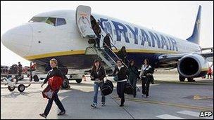 Passengers disembarking from a Ryanair aircraft