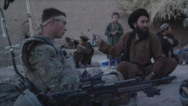 British soldier with Afghans