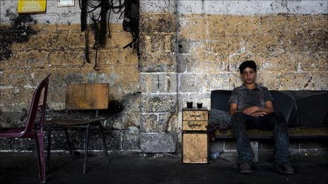 Raed Ahmed Moussa, 14, at his workshop, July 2010, Gaza City