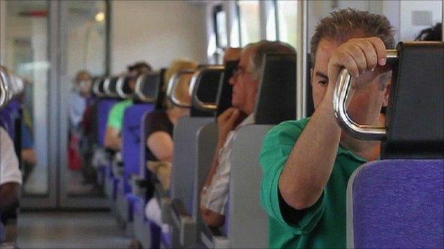 A man rides a train in Greece