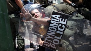 Man being arrested during recent protests in Athens against the Greek austerity measures