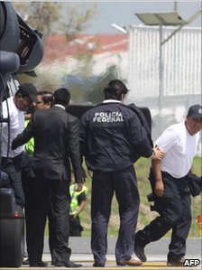 Journalists Javier Canales Fernandez (L) of Multimedios Torreon and Alejandro Hernandez Pacheco (R) of Televisa are escorted out of an helicopter on 31 July after being rescued
