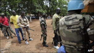 Former New Forces soldiers arrive to hand in weapons to peacekeepers in June 2010