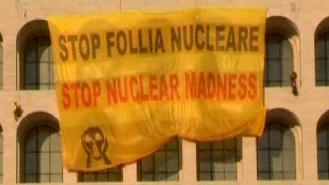 "A Greenpeace banner saying ""Stop nuclear madness"""