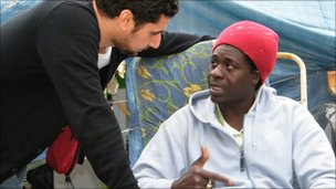 Kitchen worker Diaby Gandega gets advice from a union representative at a protest camp in Paris.