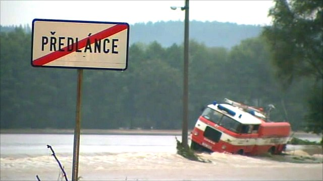 Vehicle trapped in floodwater