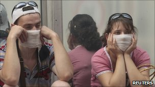 People in Moscow cover their faces from the smog