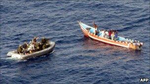 Pirates surrendering to crew of SPS Victoria