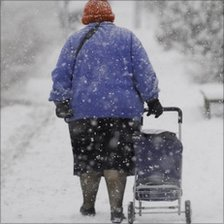 Elderly lady out in the snow
