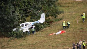Picture of plane in bushes after crash