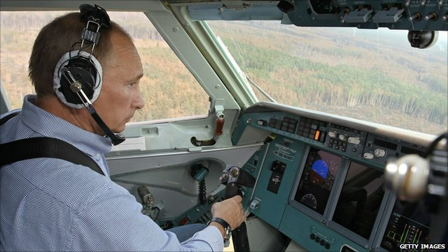 Vladimir Putin takes control of a Russian firefighting aircraft