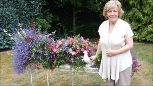 Linda Martin with some of her hanging baskets