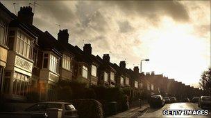 Houses under a dark sky