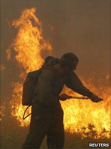 A firefighter battles flames outside Shatura, a town 110km (68 miles) south-east of Moscow, 12 August
