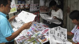 Burmese read news of the election in Rangoon, 12 August