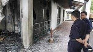 Kuala Lumpur police officers inspect the damage to the Metro Tabernacle Church