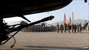 German and US soldiers take part in a ceremony at the German field camp in Mazar-i-Sharif on 16 July 2010