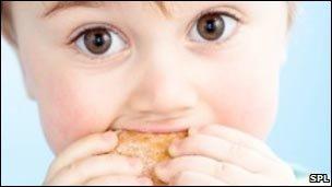 Toddler eating doughnut