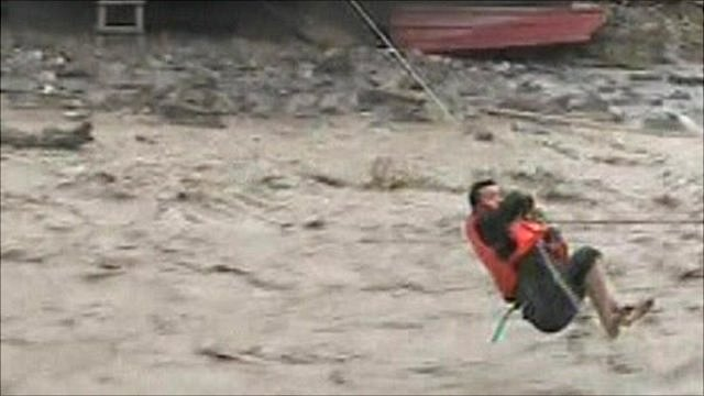 Man hanging on rope