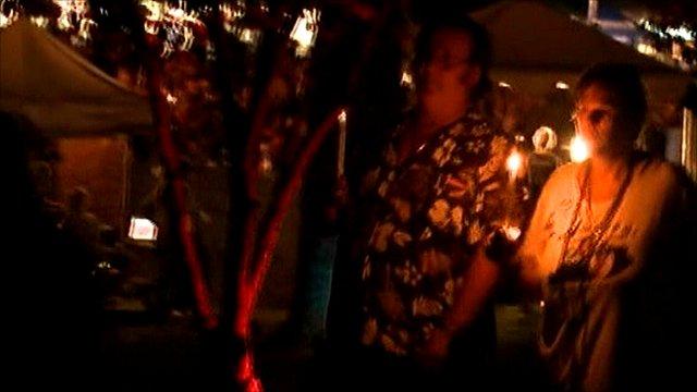 Fans light candles at Graceland