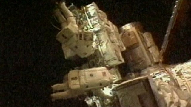 Astronauts on spacewalk at ISS