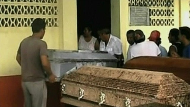 coffins are carried by relatives
