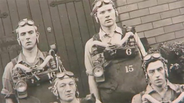 Old photograph of miners in rescue equipment