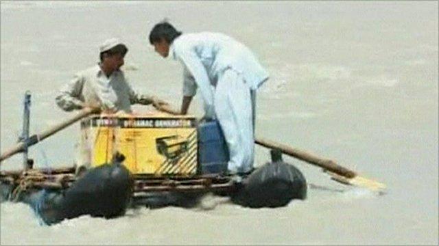 Flood victims on a makeshift raft