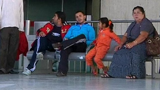 A family of Roma people waiting for their flight