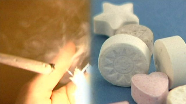 Joint being smoked and various drugs in pill form