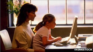 Lady on computer with daughter