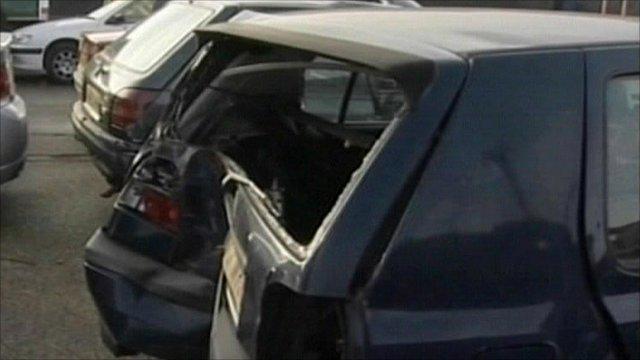 Badly damaged rear end of car