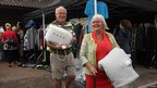 Couple leave with items from garage sale
