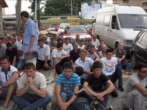 Muslims worship on the streets of Pristina outside a full mosque