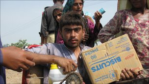 People receive aid in Sukkur